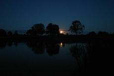 The moon rises over a calm Etang Bertie
