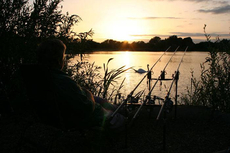 Watching and waiting, as the sun goes down Linear fisheries lovely Hardwick lake, Oxfordshire.