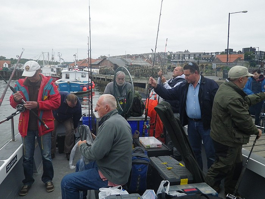 Busy anglers getting organised as Mistress leaves Whitby Harbour
